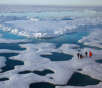 NOAA scientists explore the Arctic during a 2005 mission. CREDIT: Jeremy Potter, NOAA