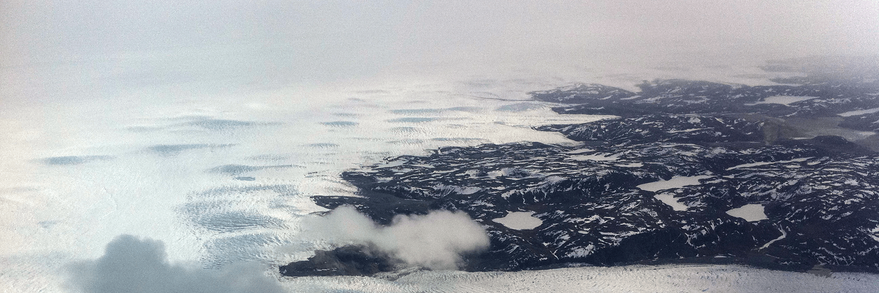 The southwest edge of the Greenland Ice Sheet, partially covered in low-level, opaque clouds. Credit: Matthew Shupe, CIRES